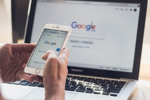 google search engine on mobile and laptop
